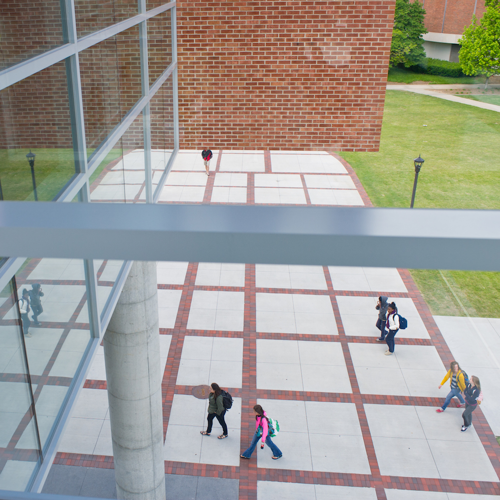 Students walking into the Clough Undergraduate Learning Commons.