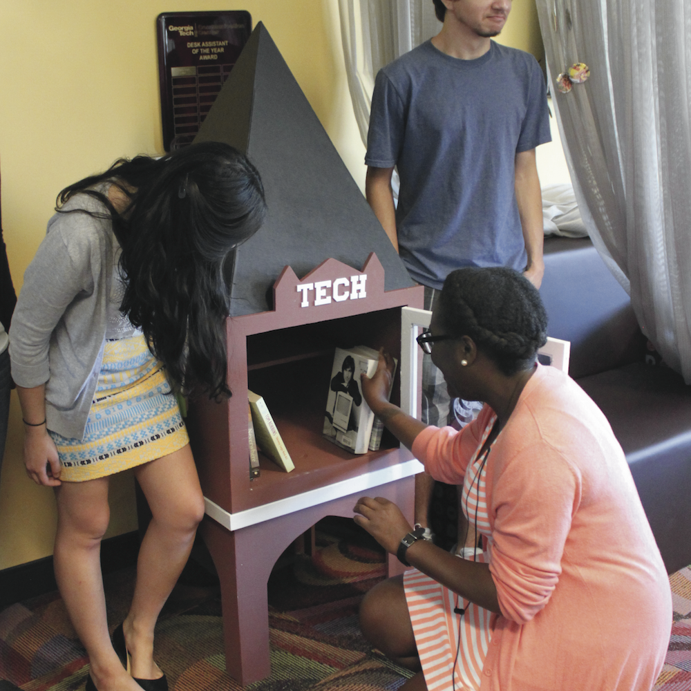 """ThinkBig participants populating the """"Little Library"""" they built."""